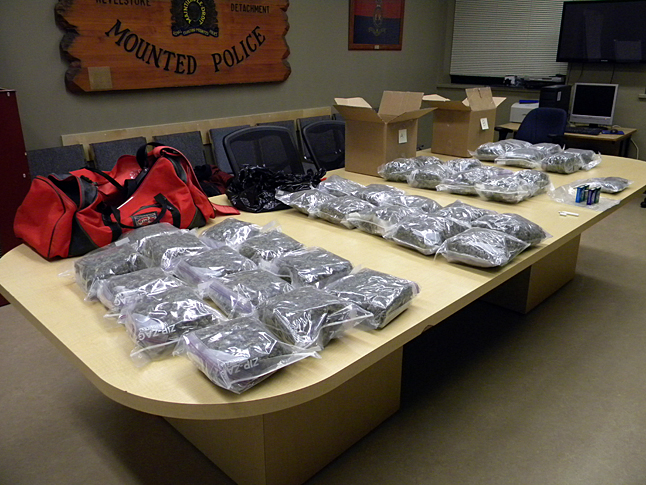 A vehicle travelling at high speed on the section of the Trans-Canada Highway passing through Revelstoke at 2:30 am on Friday, May 9, quite naturally attracted the attention of local Mounties who stopped it. The vehicle was later determined to contain a large quantity of marijuana. A total of 18.5 lbs of marihuana was seized, with an estimated street value of $37,000. The vehicle was travelling east-bound with an unknown destination in the Prairie provinces. The Revelstoke RCMP frequently encounter large movements of marijuana through the community and appreciate that by locating these drugs that a large number of persons are spared from the harmful effects of drug usage and the criminal element that is connected to it. The public is always encouraged to contact Crime Stoppers at 1-800-222-8477(TIPS) to report any knowledge of criminal incidents. Photo courtesy of the Revelstoke RCMP