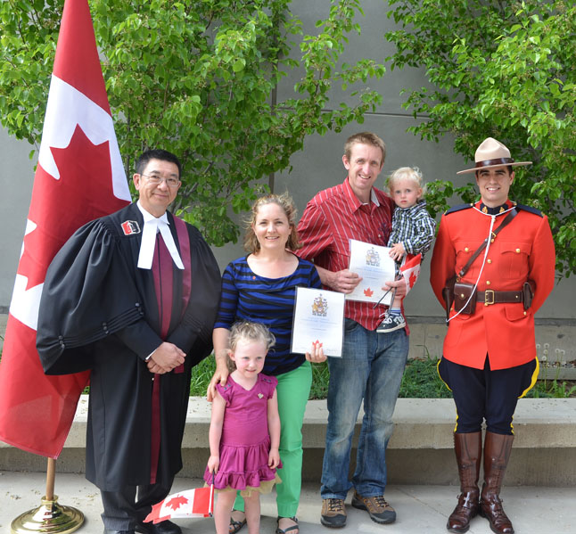 The Revelstoke Current congratulates Anita and Blair Hallewas  who were sworn in as brand-new Canadian citizens last week by Judge Roy Chew Yee Wong (left). The happy couple were originally Australian. Their kids, Ayşe and Onyx, were born in Canada and, of course, were already Canadian. Photo courtesy of Anita Hallewas