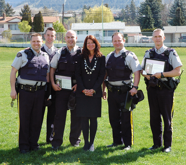 Six officers of the Revelstoke RCMP Detachment and Traffic Services Unit were among 80 Mounties from the South East District who were honoured on Tuesday, April 29, for their part in reducing the number of alcohol and drug related deaths on BC Highways. Team Alexa was created by the family of four-year-old Alexa Middelaer who was tragically killed by an impaired driver in 2008. The program is a partnership between the RCMP, BC Ministry of Justice, BCAA, ICBC, and the BC Attorney General to reduce the number of deaths caused by alcohol and/or drug impaired drivers by 35 percent by the end of 2013. To date 313 Team Alexa Members have surpassed that number to achieve a 52 percent decrease in deaths on our highways.  This means 190 lives have been saved.  Constables Gary McLaughlin (TCETS), Jason Spielman (IRSU), Gord Just, Dave Segers, Ted Yadernuk (TCETS), and Corporal Mike Wasylenki (TCETS), were honoured by Laurel Middelaer (center), Alexa's mother, at a ceremony in Kelowna and collectively have taken over 100 impaired drivers off highways in our area. Photo courtesy of the Revelstoke RCMP