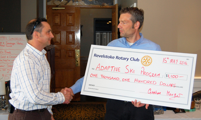 Ron Glave of the Revelstoke Adaptive Ski Program (left) shakes hands with Rotary Club President Graham Harper as he accepts a cheque for $1,100 during the club's regular noon meeting at the Regent Hotel on Thursday, May 15. The program supports the efforts of disabled people to participate in winter skiing. To find out more about the program please visit its Facebook page at https://www.facebook.com/revelstokeadaptive.  David F. Rooney photo