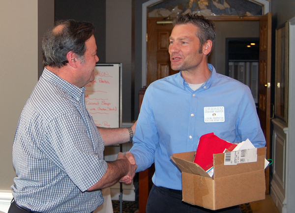 Dennis Gray (left) was the lucky winner of the Rotary Club's Mother's Day draw. Here he accepts a box chock full of gift cards from local restaurants and shops that the club purchased for this draw. David F. Rooney photo
