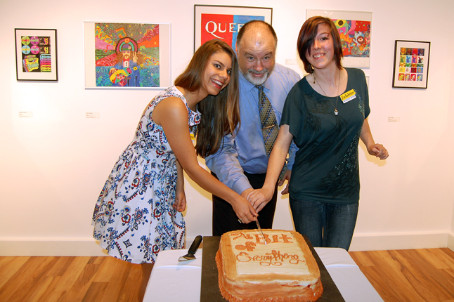 Grade 12 students Taryn Walker (left) and Madeline brown (right) joined with RSS Principal Greg Kenyon to cut the cake created for the opening. The show is open to the public Tuesday through Saturday from noon until 4 pm right through until June 6. For more information please call 250-814-0261 or send an e-mail to info@revelstokevisualarts.com. David F. Rooney photo