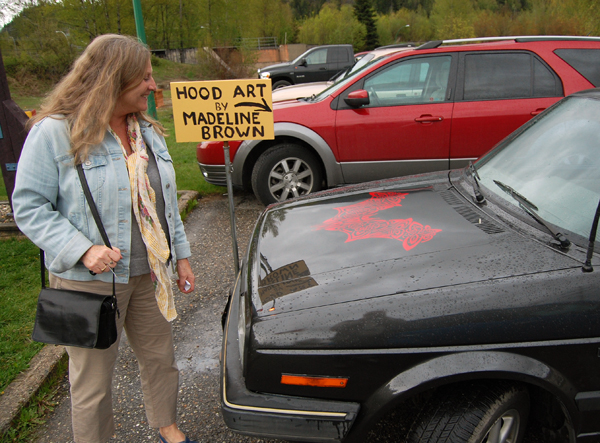 And the art extended right out the door! Here, Carol Palladino admires the art created for the hood of this car by RSS student Madeline Brown. David F. Rooney photo