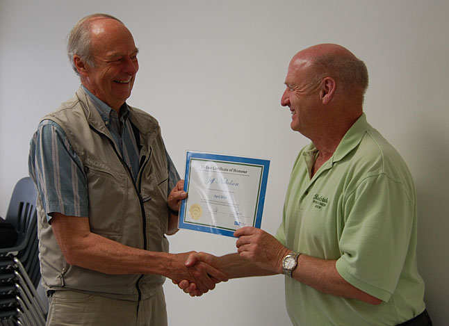 SD 19 School Board Director Jeff Nicholson (left) smiles as he is handed a certificate honouring his 15 years on the board from SD 19 Chairman Alan Chell. Nicholson noted that he has now served one year more on the board than his wife, Mengia, did. David F. Rooney photo