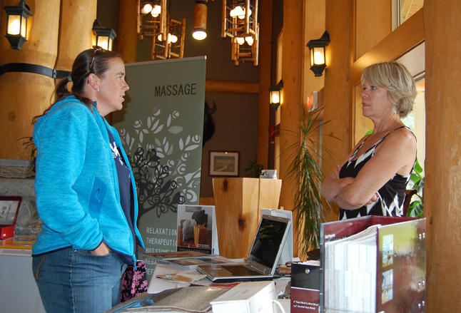 Vicki Hemingson (right) of VH design talks about interior decorating with a curious attendee at the Chamber of Commerce's Spring Expo on Sunday. David F. Rooney photo