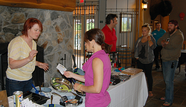 Nicole Cherlet (left) and her husband Glen (center, in the red shirt) of Big Mountain Kitchen & Linen talk with prospective clients at Spring Expo. David F. Rooney photo
