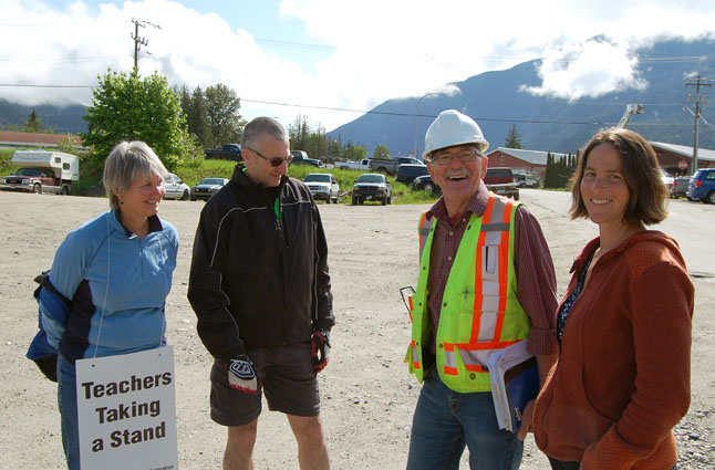 Local teachers were out on strike on Tuesday, May 27. These three shared a moment with Downie Timber's Alan Smythe who good-naturedly suggested they might be able to find work at the mill if the teachers' union negotiations with the provincial government don't work out. David F. Rooney photo