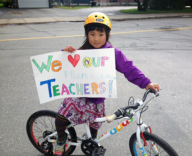Young Lia Morrow cycled up to the picket line at Begbie View Elementary School to present teachers with this heart-felt token of her support. Amanda Adam photo