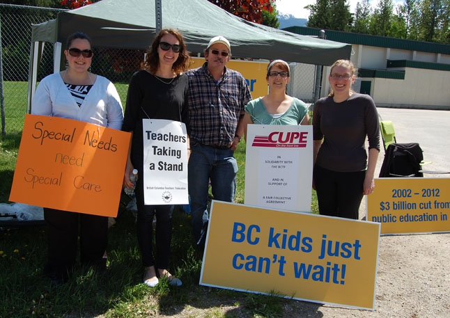 Teachers and CUPE members at Columbia Park Elementary not only walked the picket line on Tuesday but they took a few moments to wish teacher Tracey Hill (second from the left) a happy birthday. Picketing on your birthday?  Now that's dedication! Cheers, Tracey. David F. Rooney photo