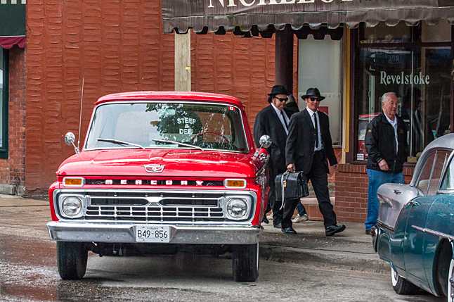 """Don Hawker takes Blues Brothers """"Jake"""" and """"Elwood"""" for a walk down First Street. Jason Portras photo"""