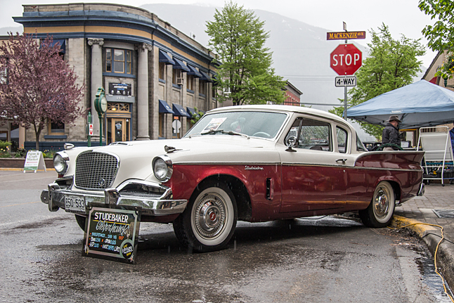 Despite the on-and-off rain showers, it was a very well attended event. Here, Dennis Beraducci's '57 Studebaker gleams in the rain. Jason Portras photo