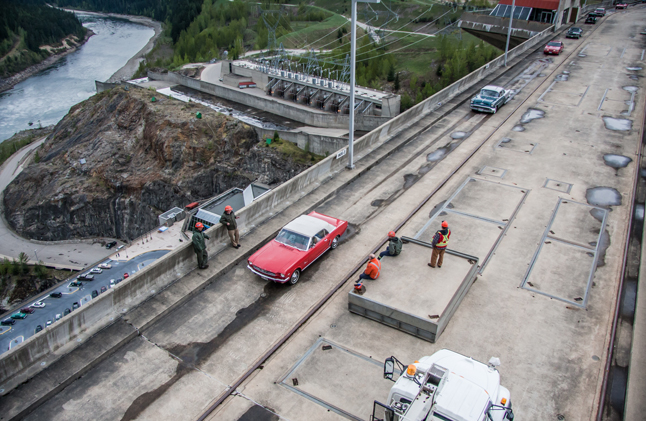A crew of hardworking BC Hydro employees takes their break at an opportune moment, allowing them to watch as the parade of classic beauties stroll by.  Jason Portras photo