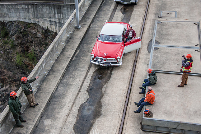 """Rudy Funfer, retired BC Hydro electrical foreman at the Dam, gets out of his car to teasingly tell the men: """"Alright guys, it's time to get back to work!"""" Jason Portras photo"""