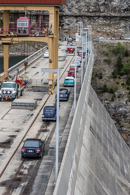 The cars leave the dam crest, headed out onto Hwy 23 North.  Jason Portras photo