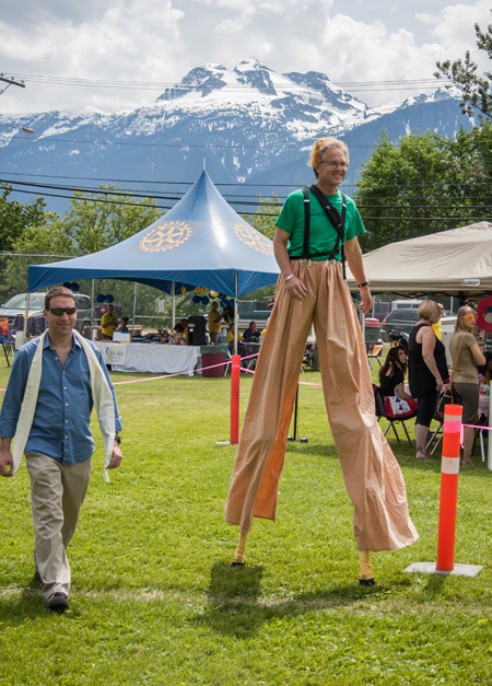 United Church Minister Ken Jones was the Lion-Giraffe Man on stilts strides along with Glen McTaggert. Jason Portras photo