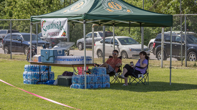 Southside Market offered a mountain of free bottled water to all participants and spectators. It was a very welcome prize on this sweltering June day. Jason Portras photo