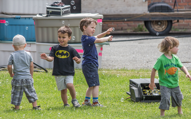 Team Gloria provided a bubble machine to the great enjoyment of these little guys. Jason Portras photo