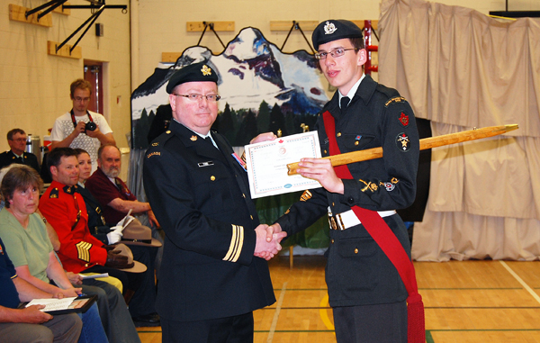 Maj. Thor Toms presents MWO Trevor Gallicano with the Lord Strathcona Medal. The Lord Strathcona Medal is the highest award that can be bestowed upon a Canadian cadet in recognition of exemplary performance in physical and military training. Lord Strathcona's objectives in establishing his endowment were to encourage the improvement of the physical and intellectual capabilities of cadets and foster patriotism in cadets through the acquisition of a good knowledge of military matters. David F. Rooney photo