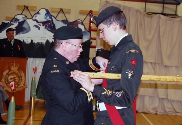 Maj. Toms pins the Lord Strathcona Medal on MWO Trevor Gallicano. David F. Rooney photo