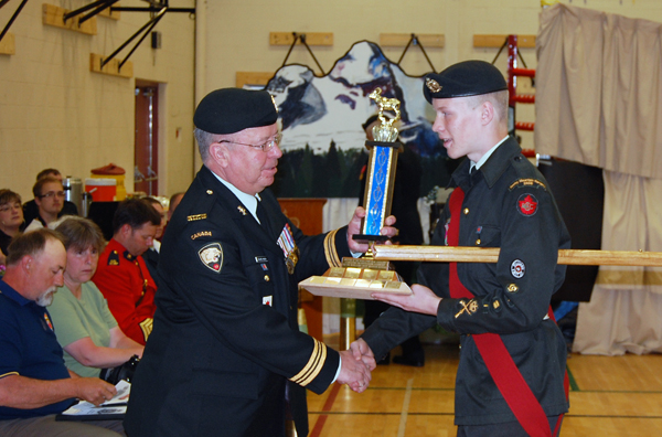 Maj. Blake-Knox presents Warrant Officer Alex Tilden with the Outstanding leadership Award. David F. Rooney photo
