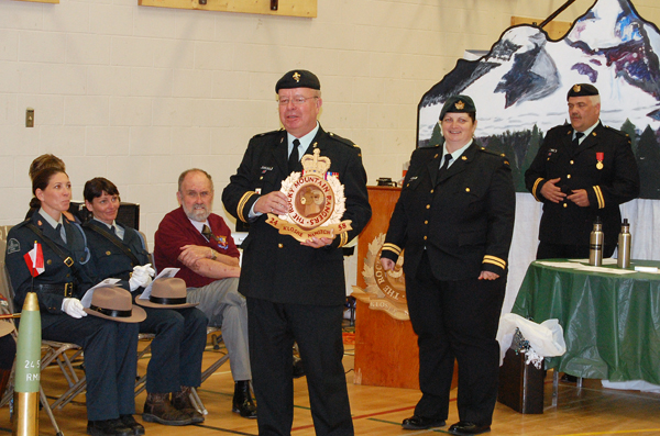 Maj. Blake-Knox was presented with a wooden copy of the 2458 Rocky Mountain Rangers Cadet Corps emblem by Capt. Miken Rienks. David F. Rooney photo