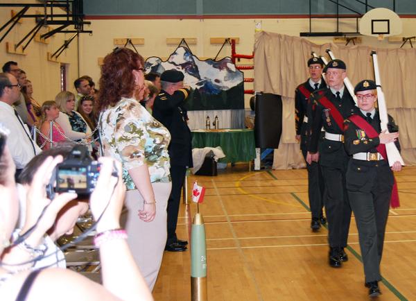 The Rifle team exits the auditorium. David F. Rooney photo