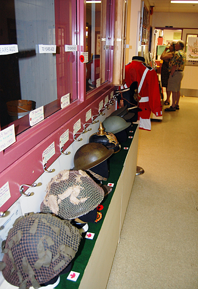 The 2458 Rocky Mountain Rangers are assembling materials for a small museum. These helmets are among the objects on display. David F. Rooney photo