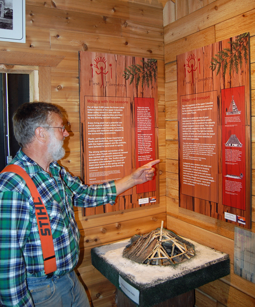 Brian Sumner describes the small but new aboriginal people's exhibit at the museum. David F. Rooney photo