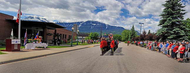 About 160 townsfolk, many of them showing their solidarity by wearing red, attended Tuesday's poignant memorial service at the local RCMP detachment to honour the three officers killed by a lone gunman in Moncton on June 4. Photoshop panorama by Dusty Veideman