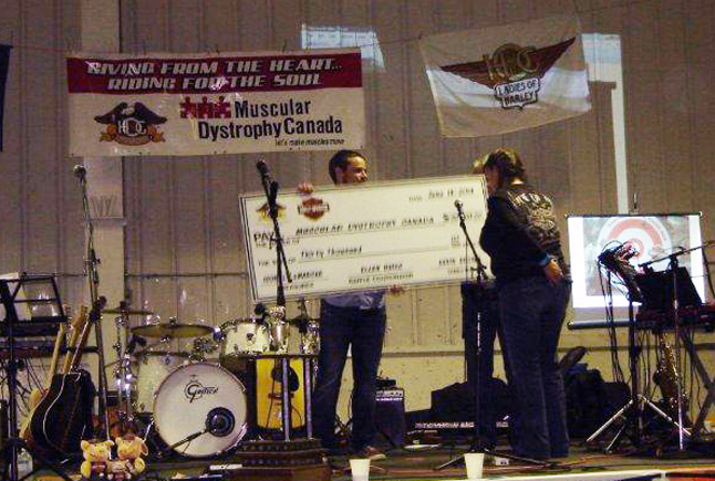 A representative of Muscular Dystrophy Canada accepts a $30,000 from the Kamloops Harley Owners Group. The 30 grand was raised through the groups popular the 2014 Harley Raffle. Photo  courtesy of Glen Richardson