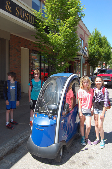 The kids in Sue Leach's Grade 4/5 class from Columbia Park Elementary School went walk-about downtown on Wednesday when they encountered this surprisingly small vehicle on First Street West. Dane, Jonah, Savanah, Isobel kindly posed with the vehicle. David F. Rooney photo