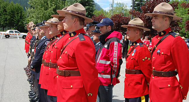 RCMP Members and those who marched with them stand easy in front of the detachment.  David F. Rooney photo