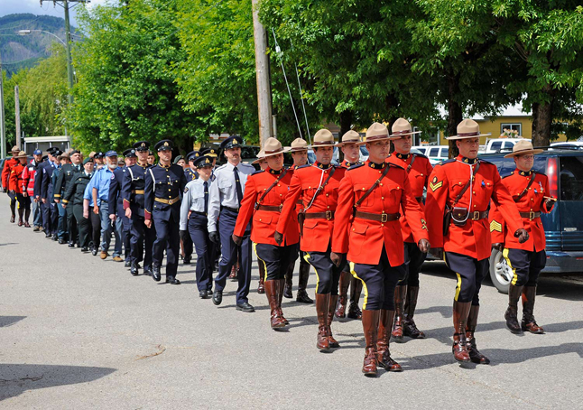 Police and emergency services personnel march to honour the fallen heroes of Moncton. Dusty Veideman photo