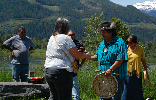 Jackie Cole presents a gift to storyteller Ralph McBryan of the Secwepemc's Little Shuswap Band. David F. Rooney photo