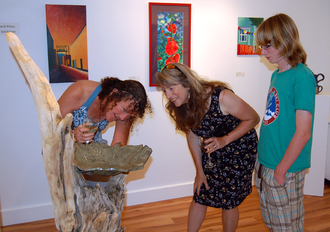 Ceramic artist Cat Mather (left) discusses the methods she used to create her piece Revy Bird Bath with painter Lucie Bergeron and son Daniel Blackie. David F. Rooney photo