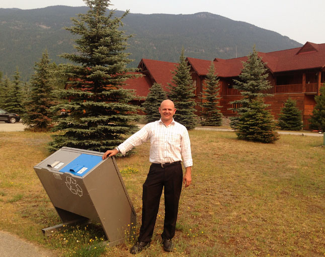 Local resorts and hotels can make a real difference minimizing human conflicts with wildlife, says Sue Davies of WildSafeBC. She said Saturday that Glacier House Resort owner Daniel Kellie (show here with his new steel bear bins) recently asked her to show his staff how to keep conflict with wildlife to a minimum. Photo courtesy of Sue Davies/WildSafeBC