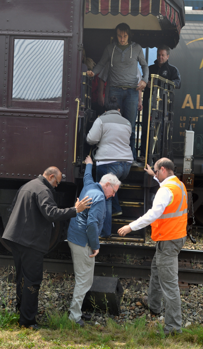 And here's that special passenger — American billionaire Warren Buffet — being helped to the ground by Mark Jackson (right), the CPR's local superintendent. David F. Rooney photo