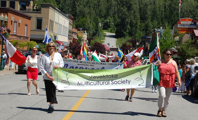 The Multi-Cultural Society members carried flags denoting the many nations whose people have come here. Multi-culturalism is one of the true hallmarks of Canada's success as a modern society. David F. Rooney photo