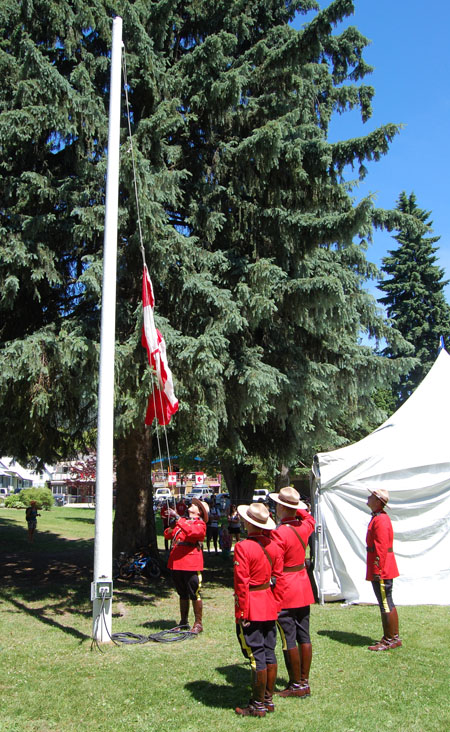 ... the flag pole's cord was so badly twisted the Maple Leaf banner could not be raised without... David F. Rooney photo