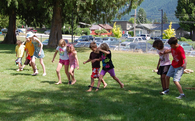 For kids who wanted to stay dry there were traditional games like a potato-sack race and a three-legged race that ended in peals of laughter. David F. Rooney photo