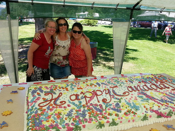 Canada Day cake queens Josee Zimanyi with her sister and Lisa Moore. Wasn't that a terrific cake? Suzanne Grieve photo