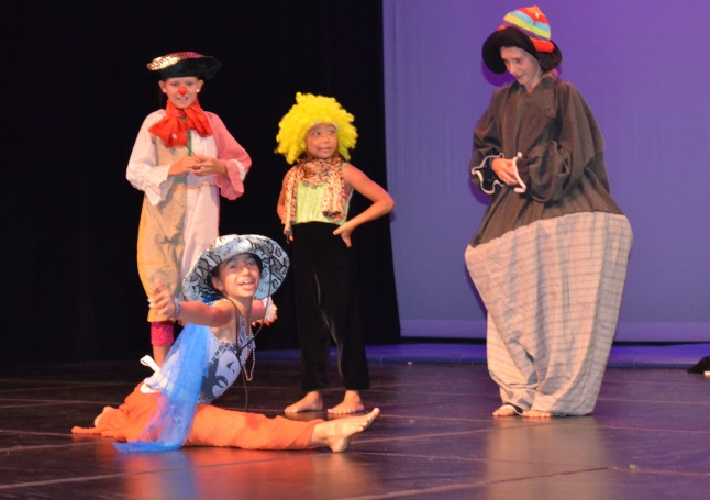 As Haley Callaghan (l), Aleisha Lepine (back centre)and Jaclyn Elliott (r) look on, Anouk Lafon (front) shows that clowns are not just funny as she falls into a split, making it look deceptively easy. Laura Stovel photo