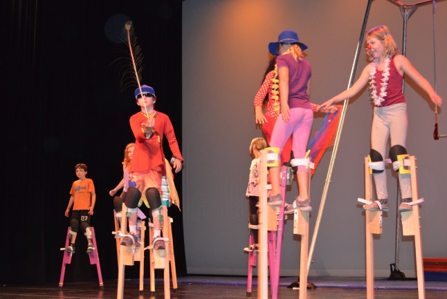 Sara and Sani Supinen, Polly and Sophie van Oort, Meya Musseau, Kaya Sproule and Rebecca Haworth stand tall on stilts while Aedan Freberg-Hickey adds a difficult feather balance to the act. Laura Stovel photo