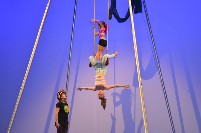 Jasmine Sproule (top) and Julia Dorrius do a double trapeze act. Laura Stovel photo