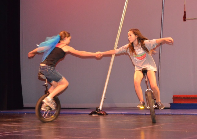 Hannah Vickers (l) and Jenna Knight (r) take unicyling a step up. Laura Stovel photo