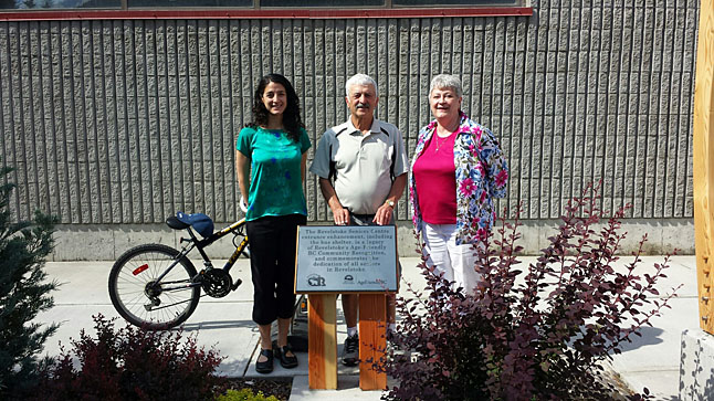 Parks, Recreation and Culture Director Laurie Donato, Acting Mayor Tony Scarcella and Seniors Association President Ruth Boettger pose beside the plaque recognizing the improvements outside the Revelstoke Senior Citizens Association building.  The addition of a new bus shelter and an attractive garden were part of an age-friendly project funded through the Seniors' Housing and Support Initiative by the provincial government.  The Senior Citizens Association also contributed financially to the project in memory of Ivy Hume.  The project was completed earlier this year. Photo courtesy of Alan Mason/City of Revelstoke