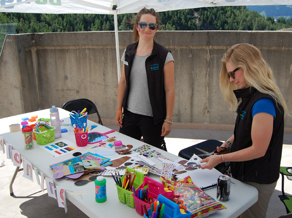 Brittany Evans and Sarah Dorn get the crafts tent ready. David F. Rooney photo