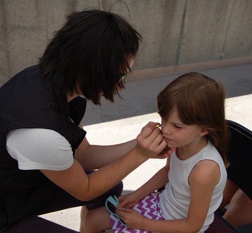 Olivia Jantz sits patiently for a face painting. David F. Rooney photo