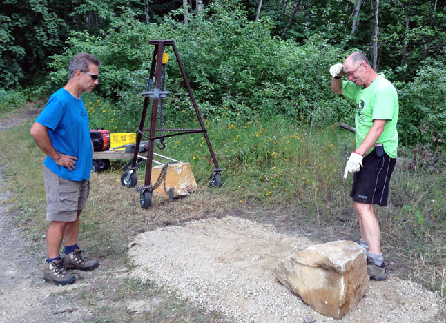 Phew! Moving the stone footings was no easy feat, even for two men in pretty good shape. Barb Kemerer photo