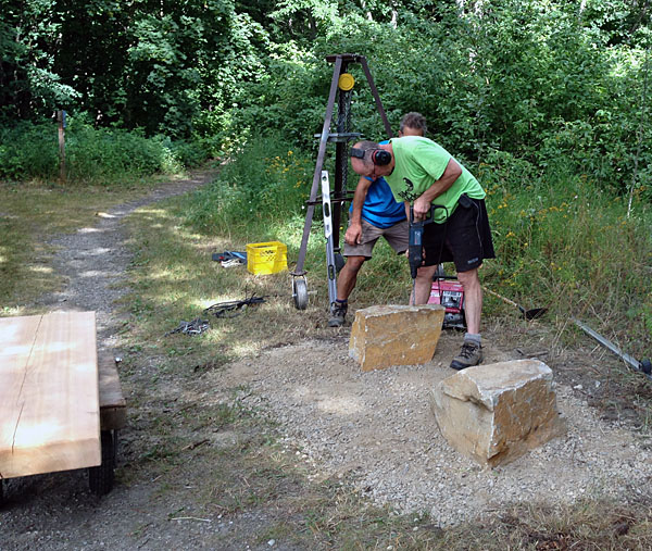 With the stones in place, Don rilled holes for metal posts that would hold the bench seat in place. Barb Kemerer photo